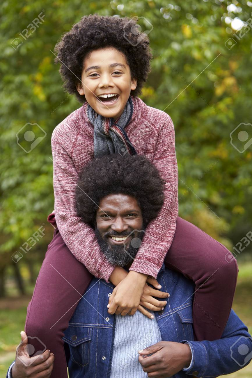 Black Middle Aged Man Carrying His Son On His Shoulders In The.. Stock  Photo, Picture And Royalty Free Image. Image 111696844.