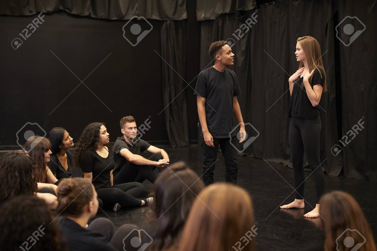Male And Female Drama Students At Performing Arts School In Studio Improvisation Class - 118540403