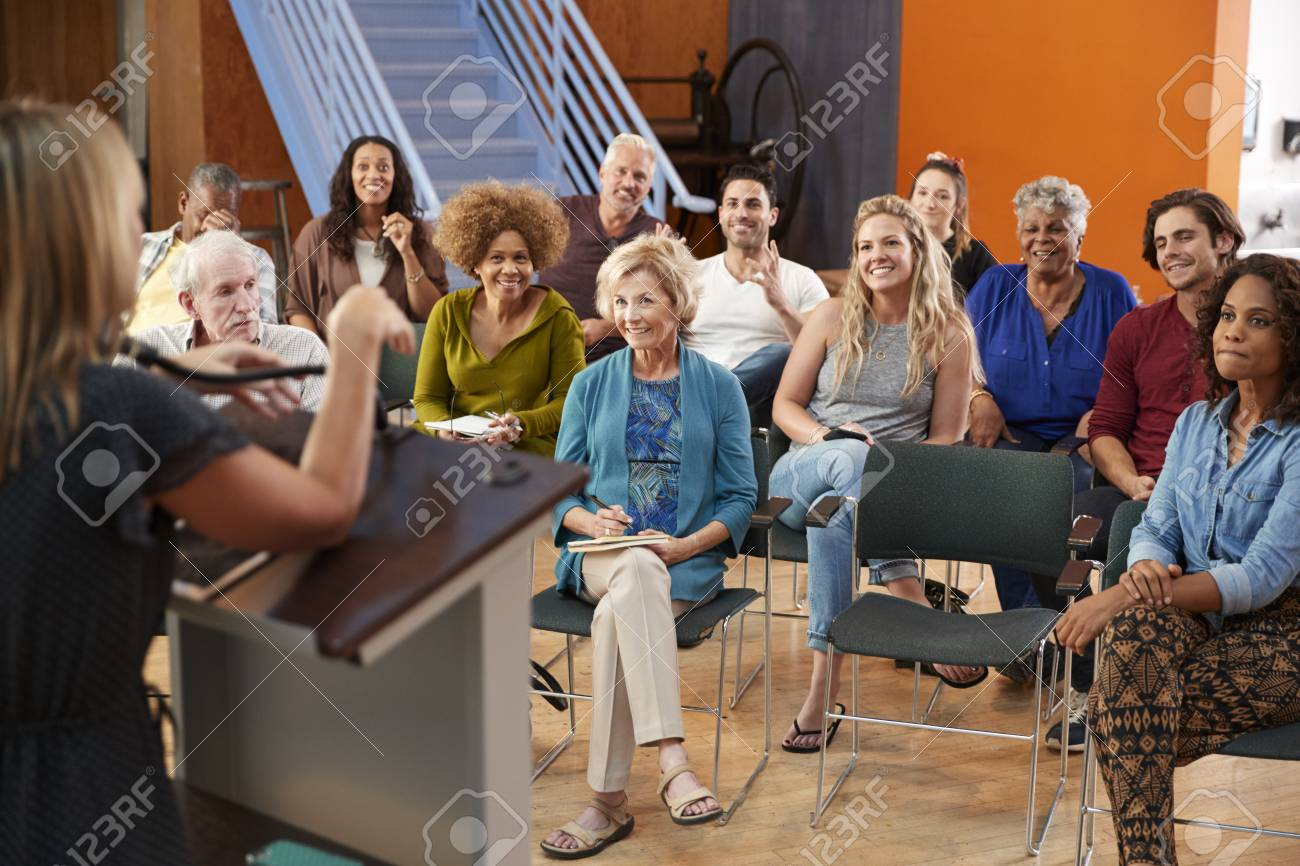 Group Attending Neighborhood Meeting Listening To Speaker In Community Center - 122609276