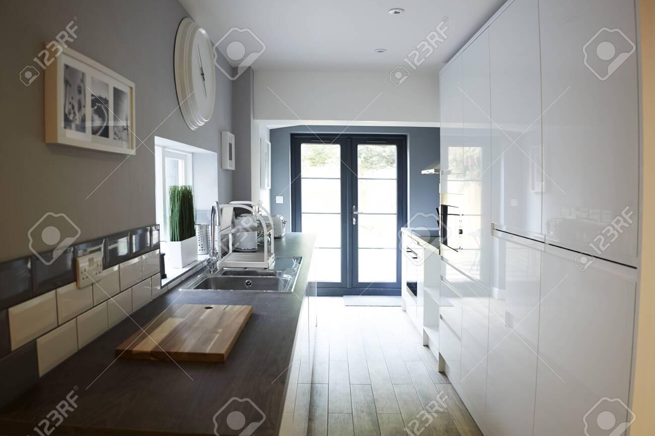 Kitchen In A Refurbished House Looking Towards Back Door