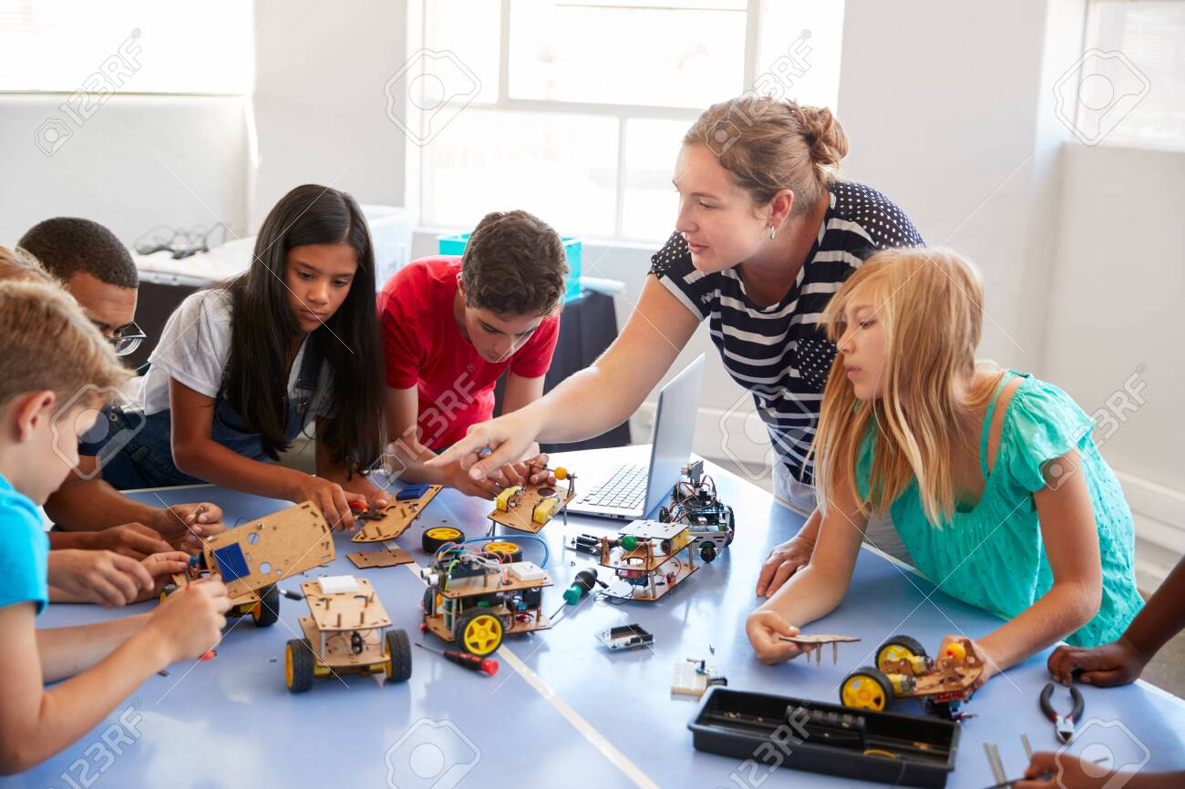 Students In After School Computer Coding Class Building And Learning To Program Robot Vehicle - 124373378