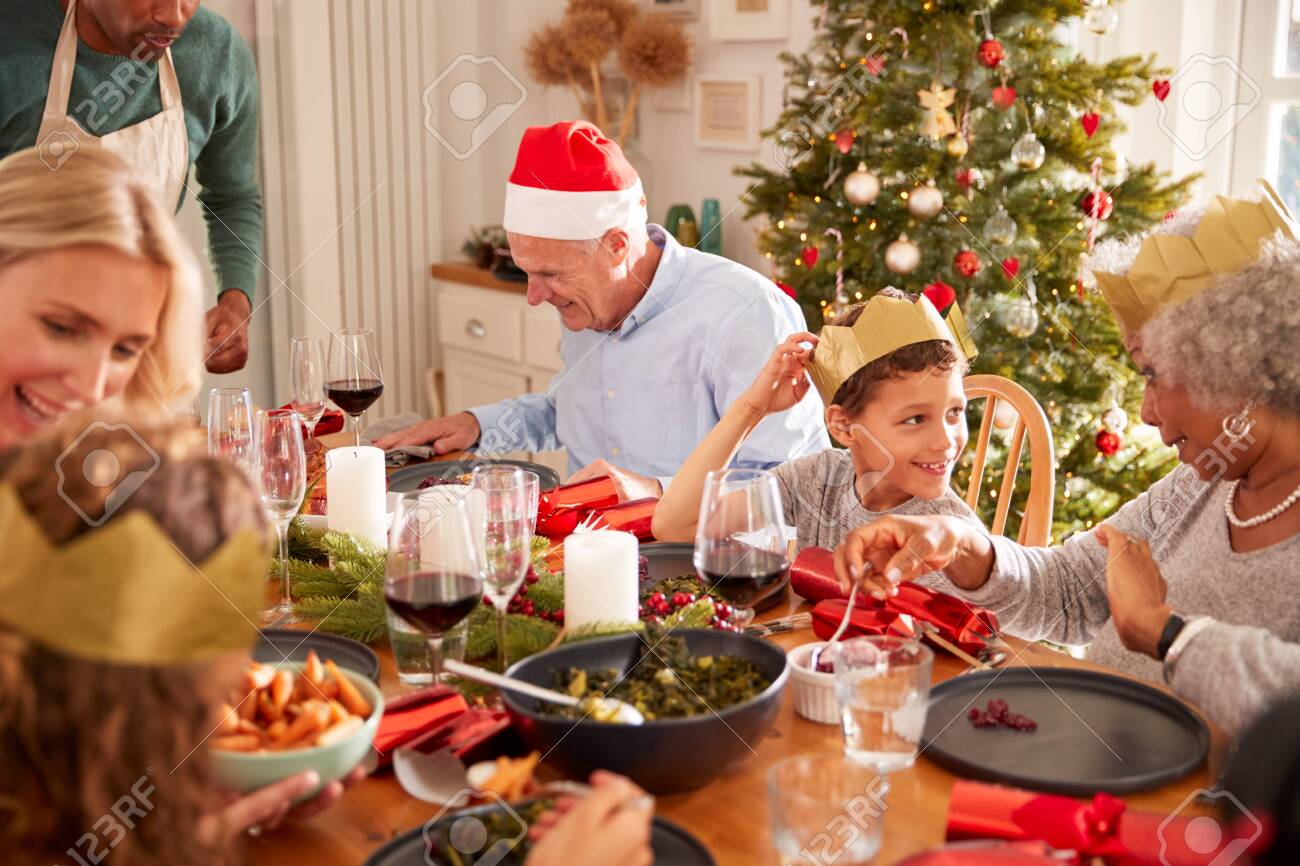 Father Serving Food At Multi-Generation Family Christmas Meal At Home - 133300923