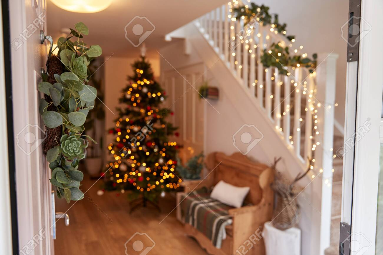 Hallway Of Home Decorated For Christmas Viewed Through Front Door - 133248620