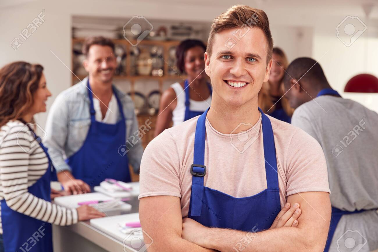 Portrait Of Smiling Man Wearing Apron Taking Part In Cookery Class In Kitchen - 137048377