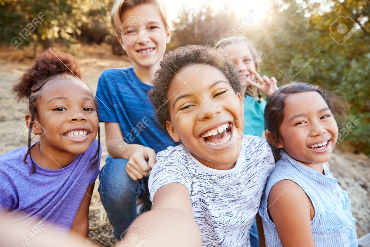 POV Shot Of Multi-Cultural Children Posing For Selfie With Friends In Countryside Together - 145533230