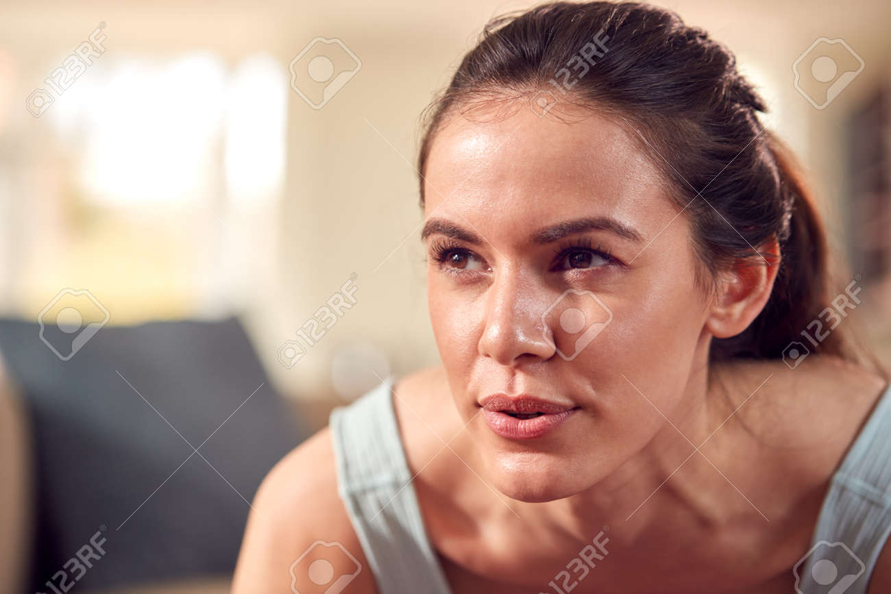 Close Up Of Woman In Fitness Clothing At Home In Lounge Doing Press Ups - 171585859