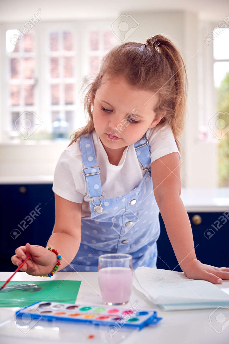 Young Girl Painting Picture At Home On Kitchen Counter - 172365351