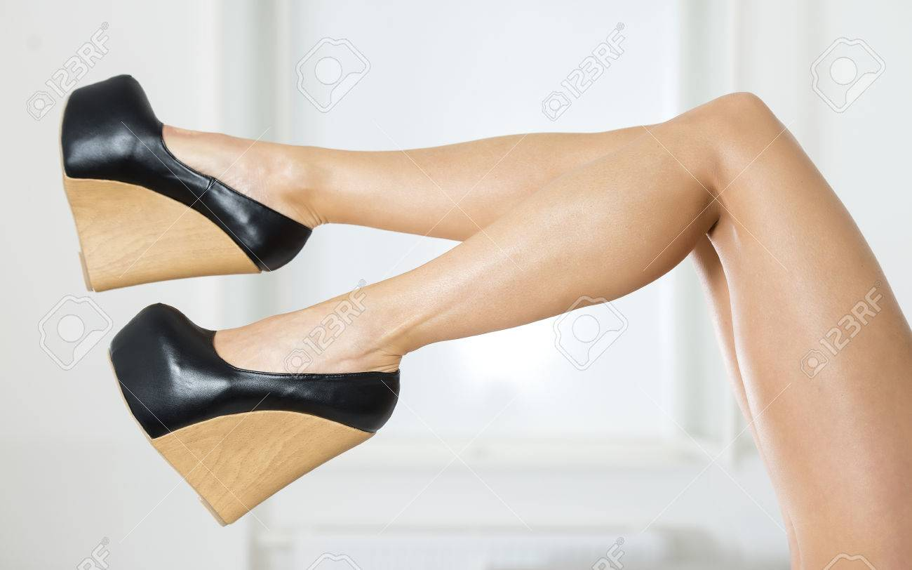 57cb9d6f35c2 Long and sexy legs in extreme platform shoes in black patent leather and wood  pattern