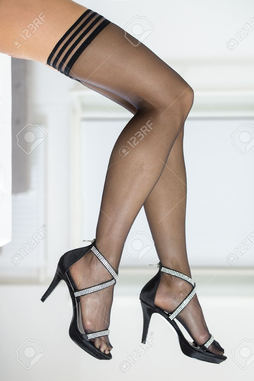 Legs Of Woman Wearing Black Stockings And Elegant High Heels ...