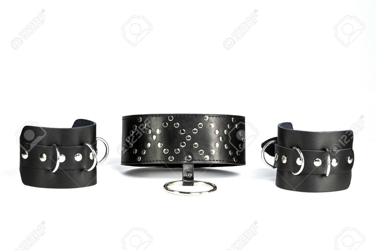Fetish Hand cuffs and  collar a made of black leather Stock Photo - 25358448