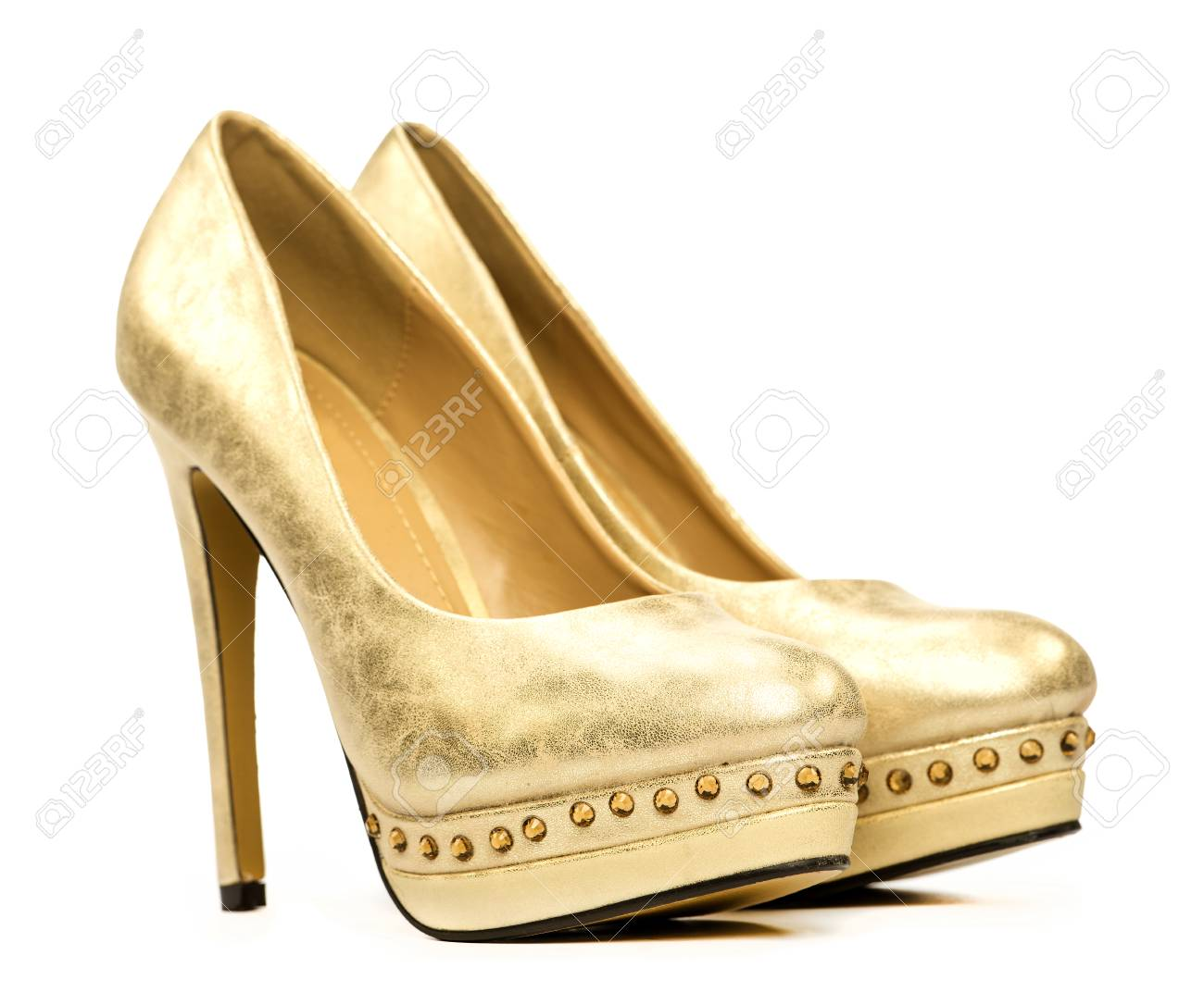 6647aa53eef Elegant platform high heels shoes in gold and with rhinestone decoration  Stock Photo - 30143921