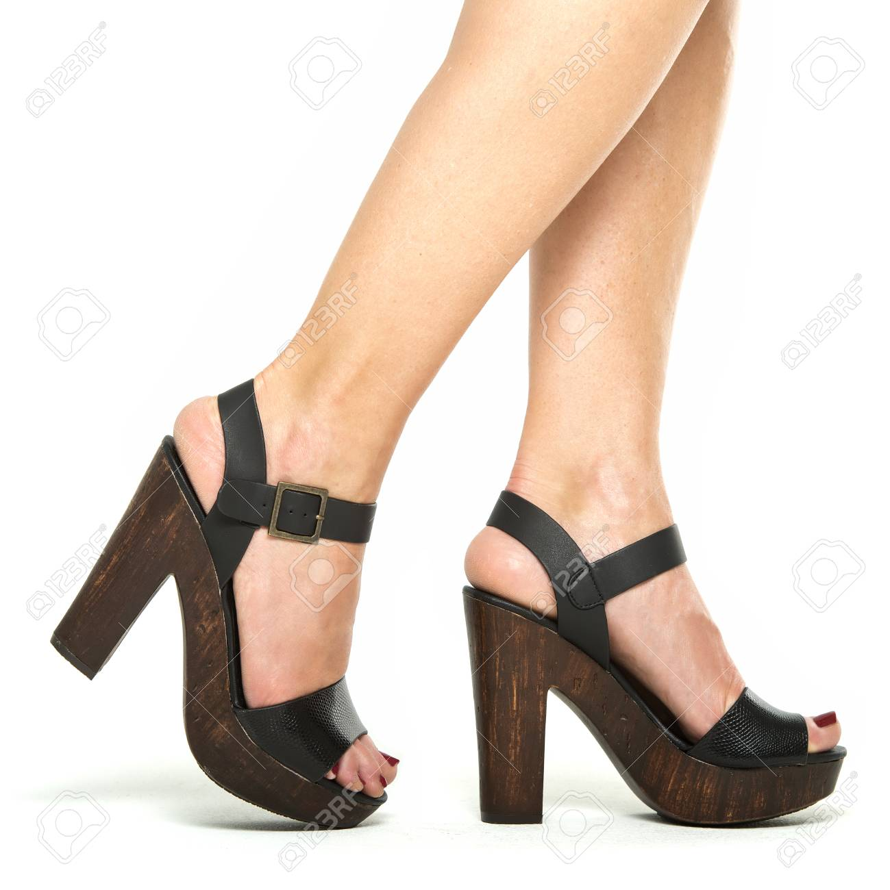 4c7b7658224 Female legs in black high heels shoes for summer with platform..