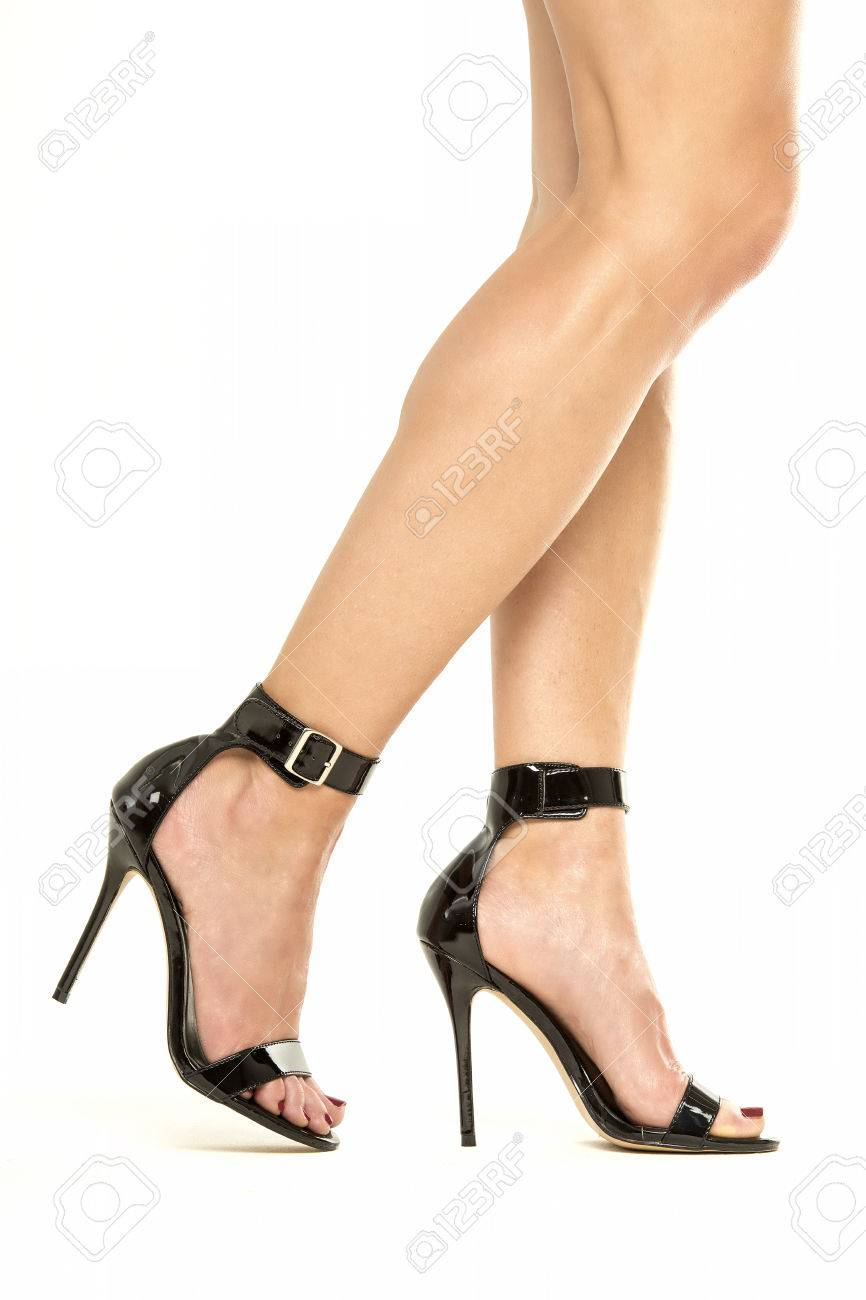 45edf31321e Female legs in black high heels shoes with ankle straps, XXXL..