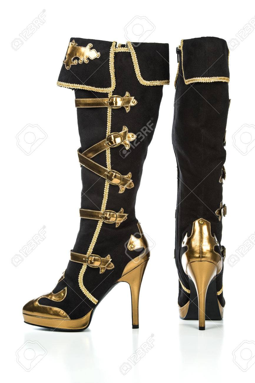 5599aad367d2e5 Extreme high heels boots with plateau sole in gold and black color Stock  Photo - 71956058
