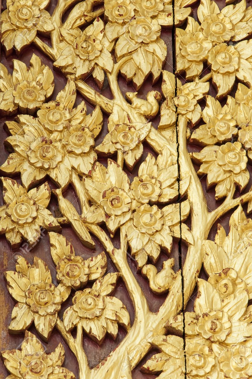 Thai style golden tree carving  handcraft with painted gold color on  wood Stock Photo - 14191799