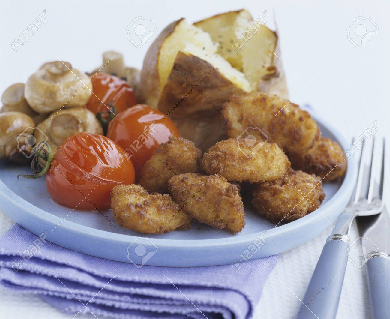 Chicken Nuggets With Tomatoes Mushrooms And Baked Potato Stock Photo 31926537