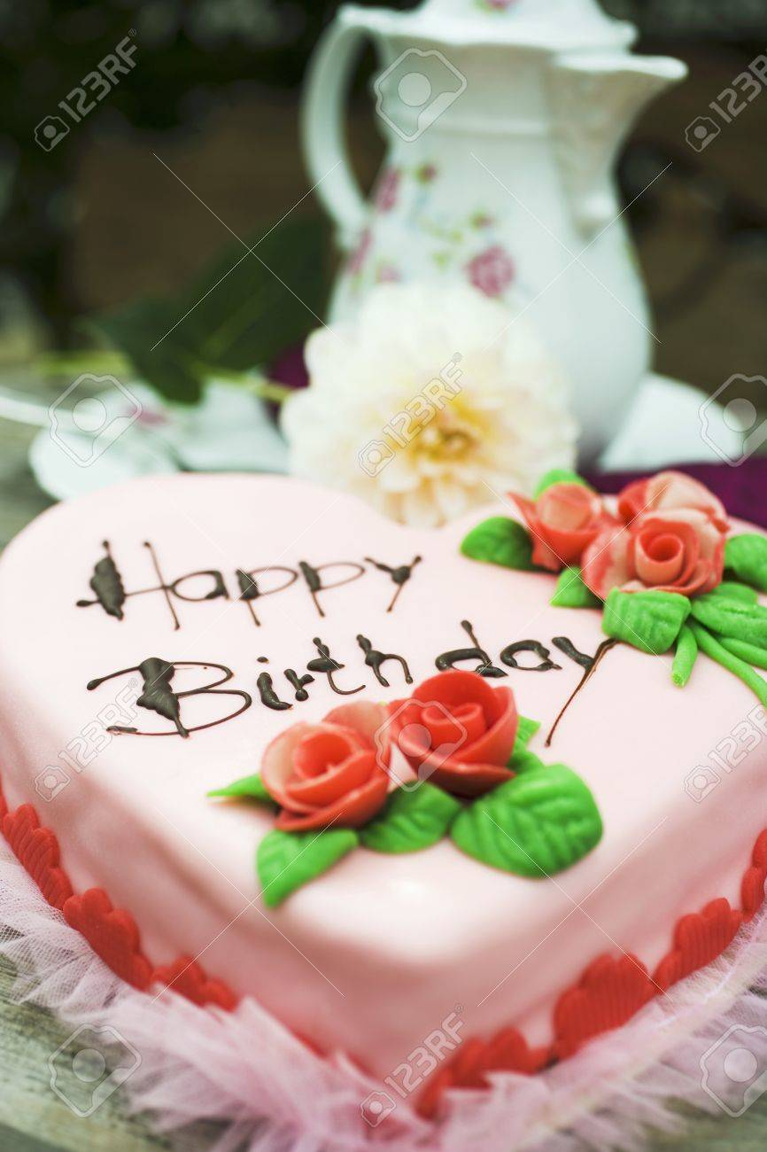 Pink Heart Shaped Birthday Cake With Marzipan Roses Stock Photo