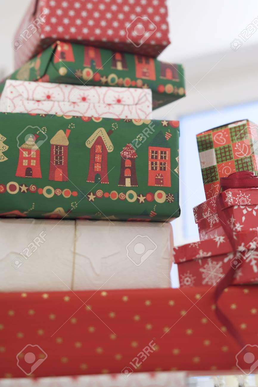 A Pile Of Christmas Gifts In Boxes Stock Photo