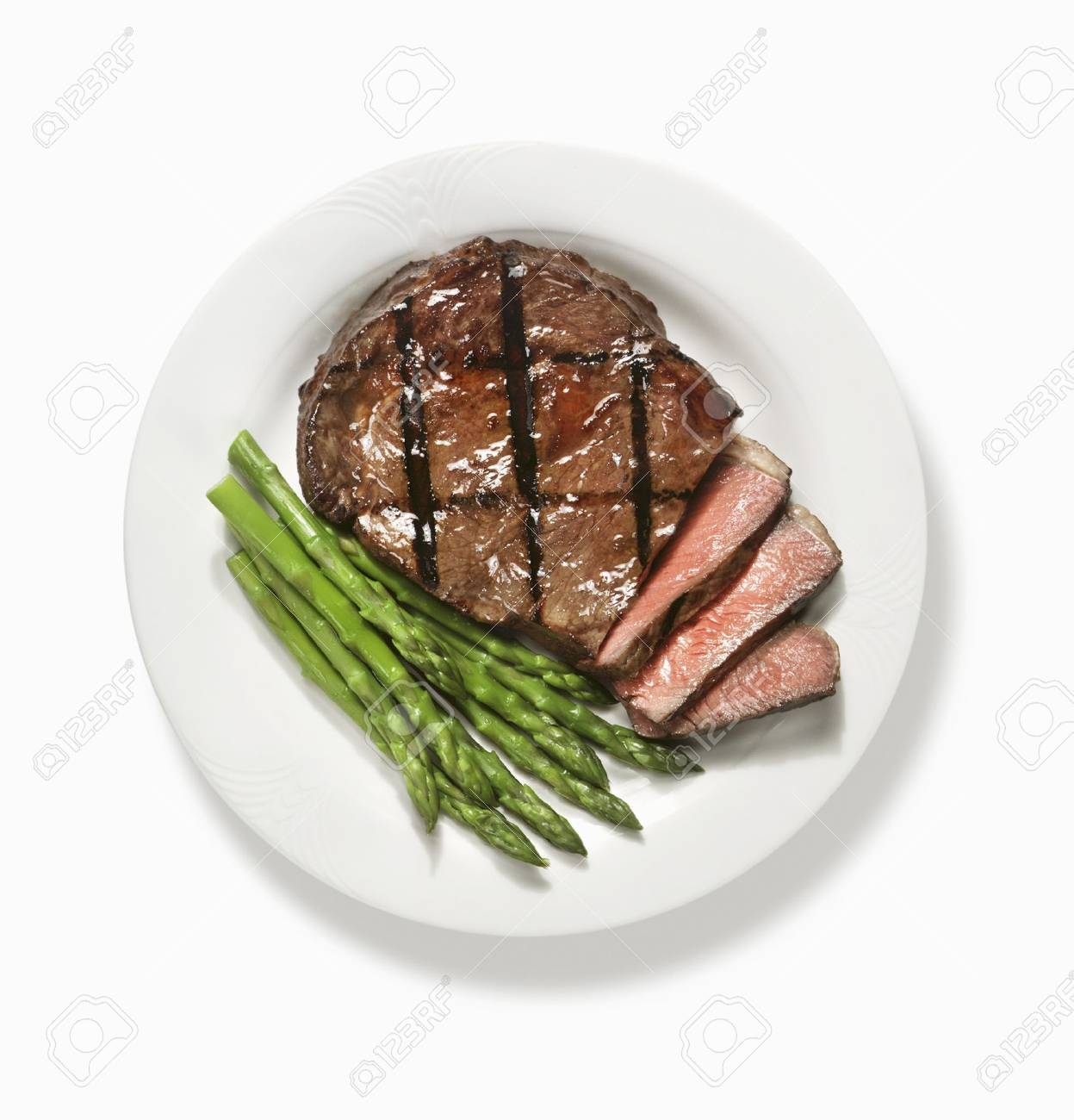 Partially Sliced Grilled Steak With Asparagus From Above Stock Photo 32391539