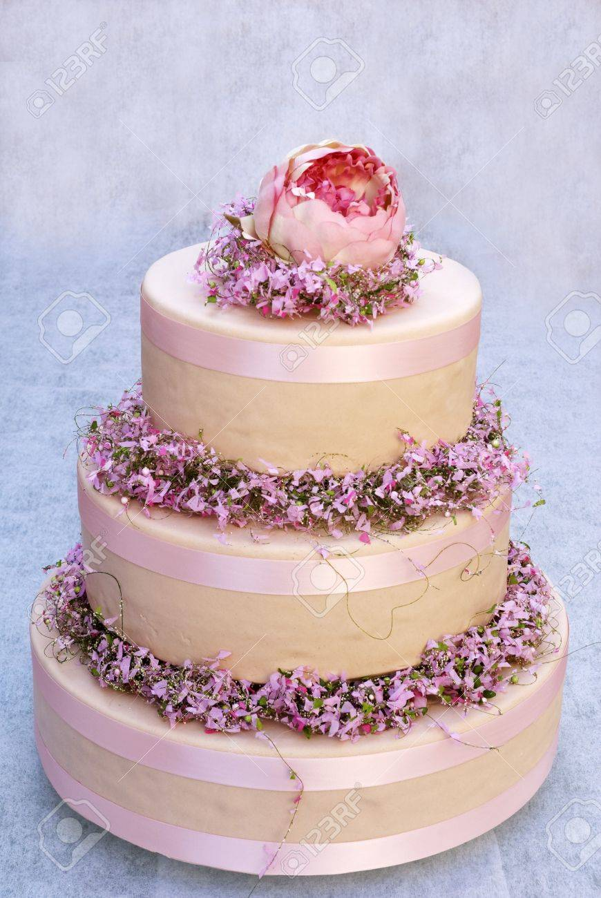Three-tiered Cream Cake With Spring Flowers Stock Photo, Picture And ...