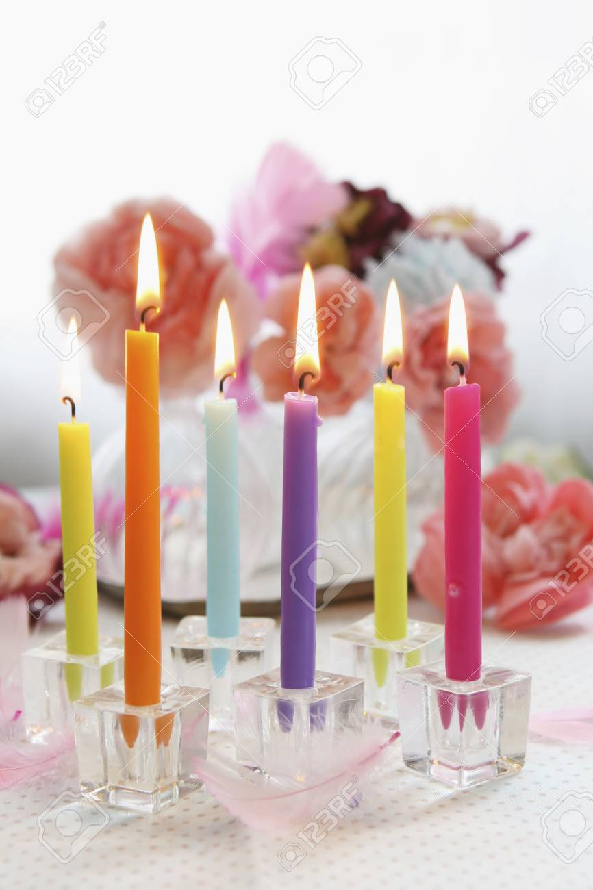 Birthday Candles And Flowers Stock Photo