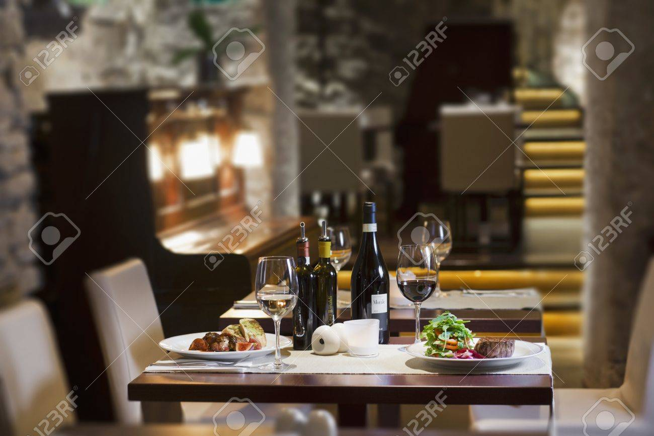 a view on the interior of the restaurant a table set for two with wine & A View On The Interior Of The Restaurant A Table Set For Two ...