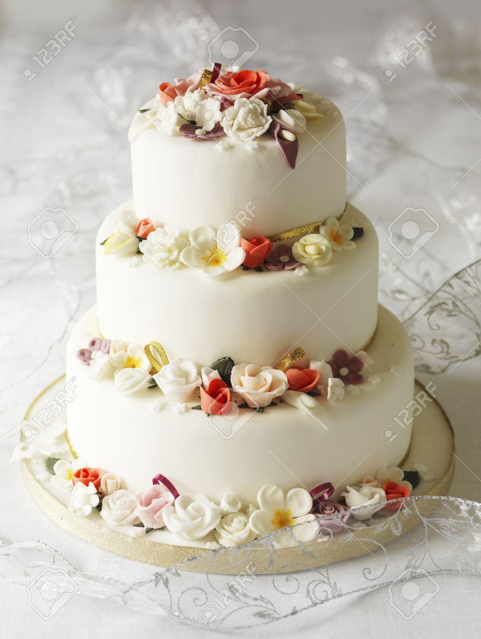 Three Tier Wedding Cake With Fondant Flowers Stock Photo