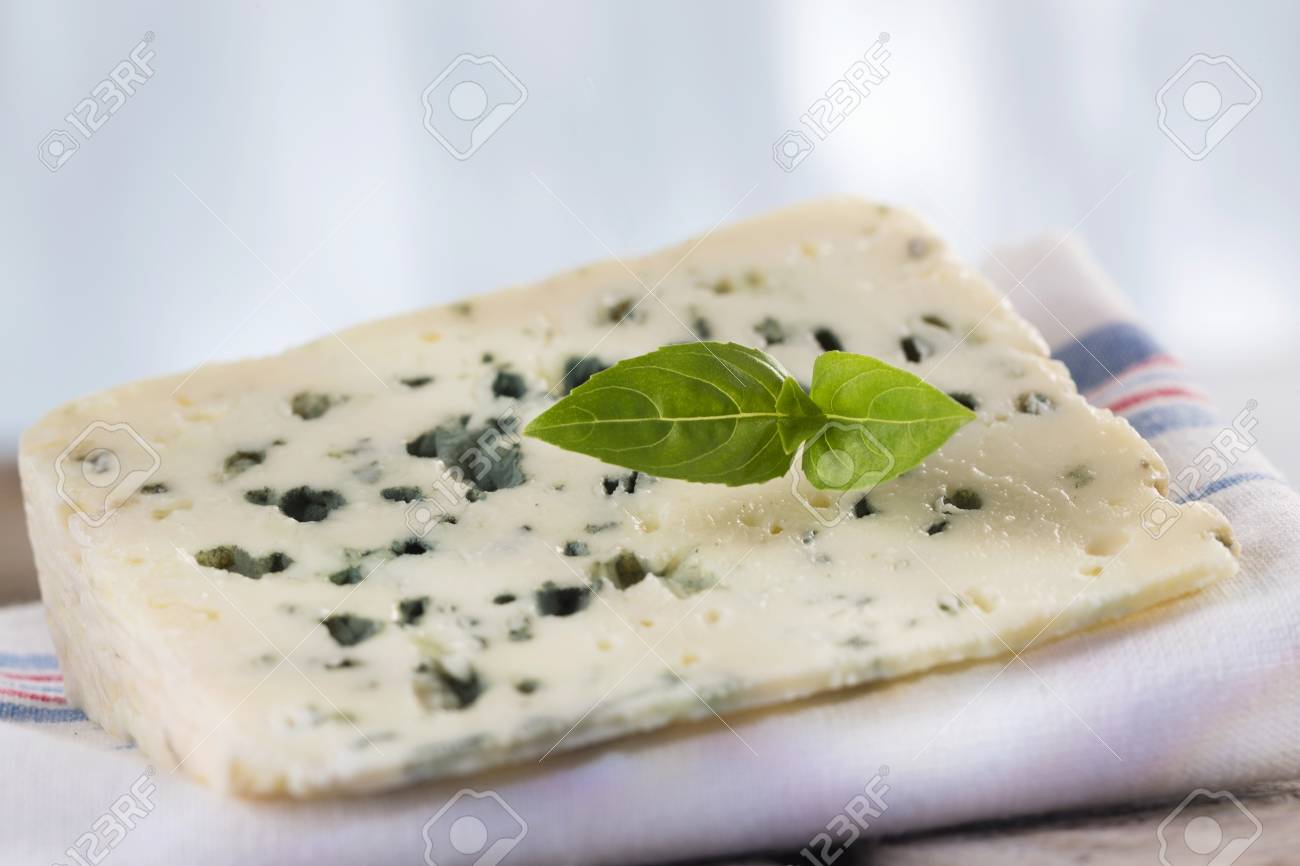 a slice of roquefort marival french blue cheese stock photo