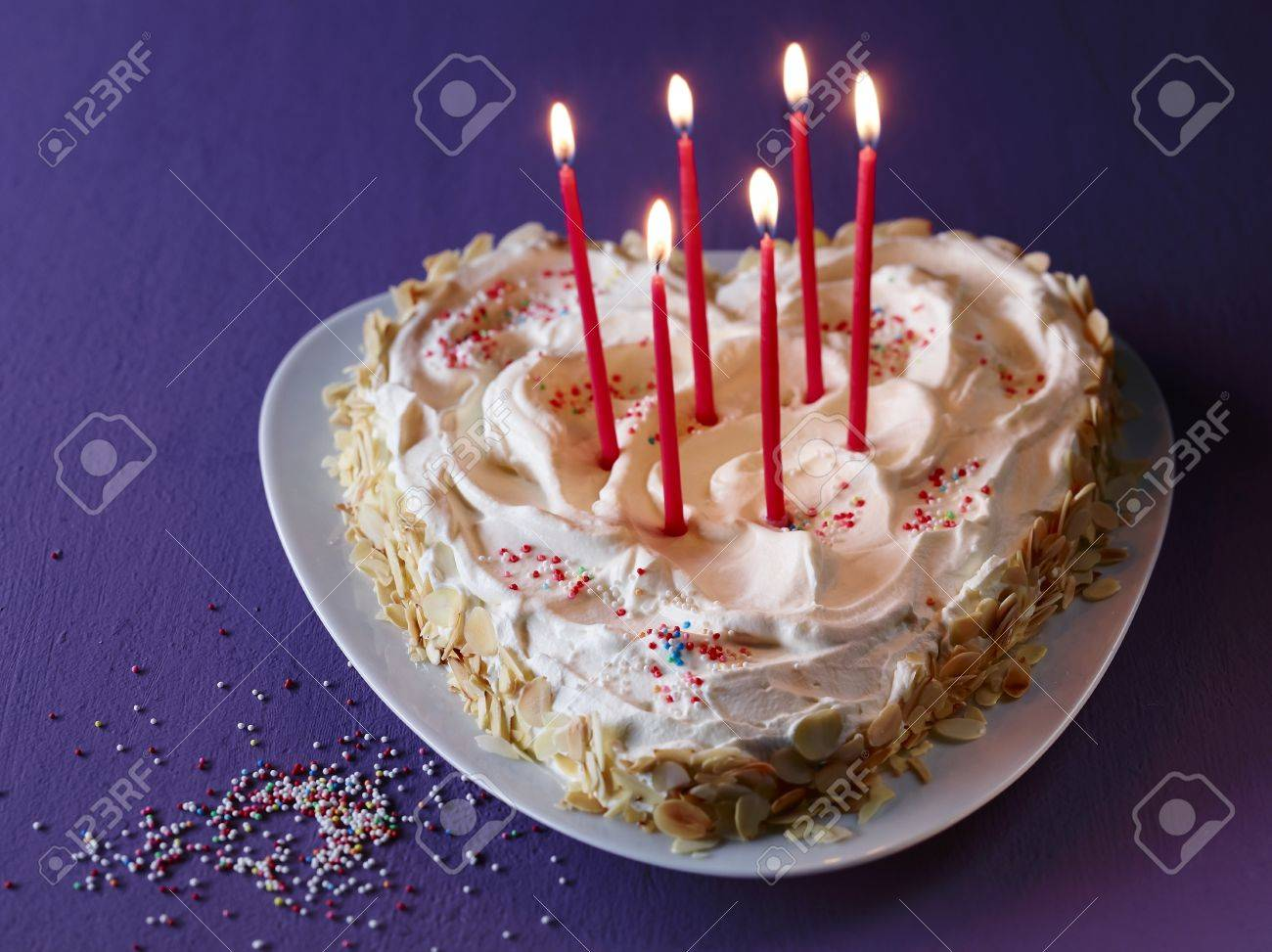 Pleasing A Heart Shaped Cake With Burning Candles For Birthday Stock Photo Personalised Birthday Cards Veneteletsinfo