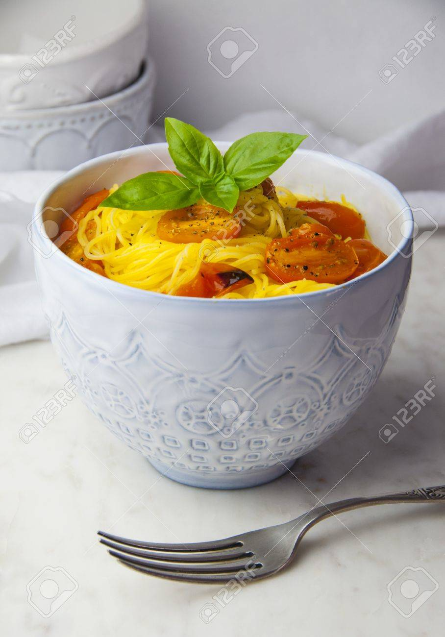 gluten free capellini pasta with roasted tomatoes and basil in