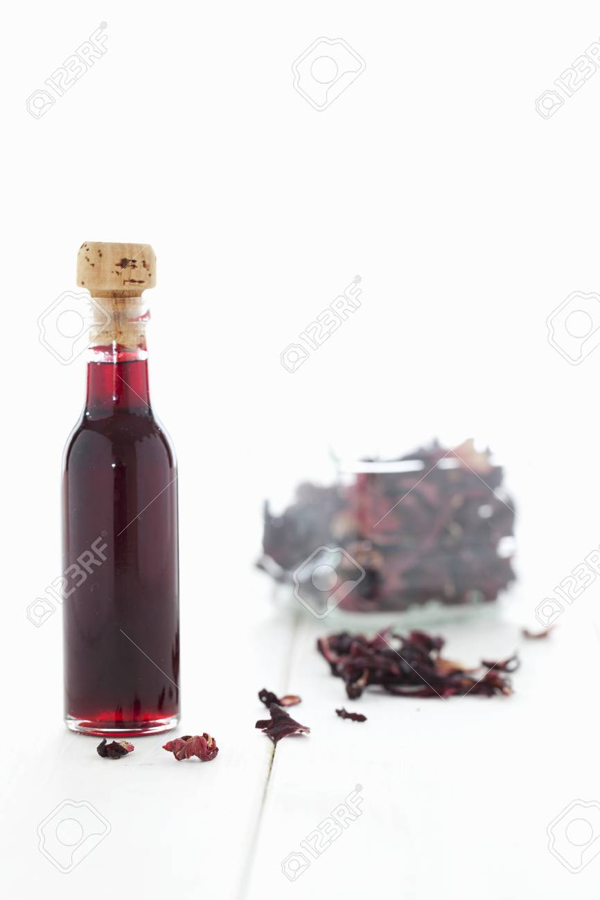 A bottle of hibiscus syrup and dried hibiscus flowers stock photo a bottle of hibiscus syrup and dried hibiscus flowers stock photo 82778581 izmirmasajfo