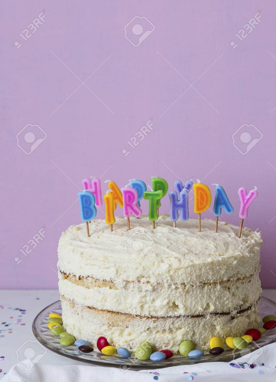 a childs birthday cake decorated with colourful letter candles stock photo 83113292
