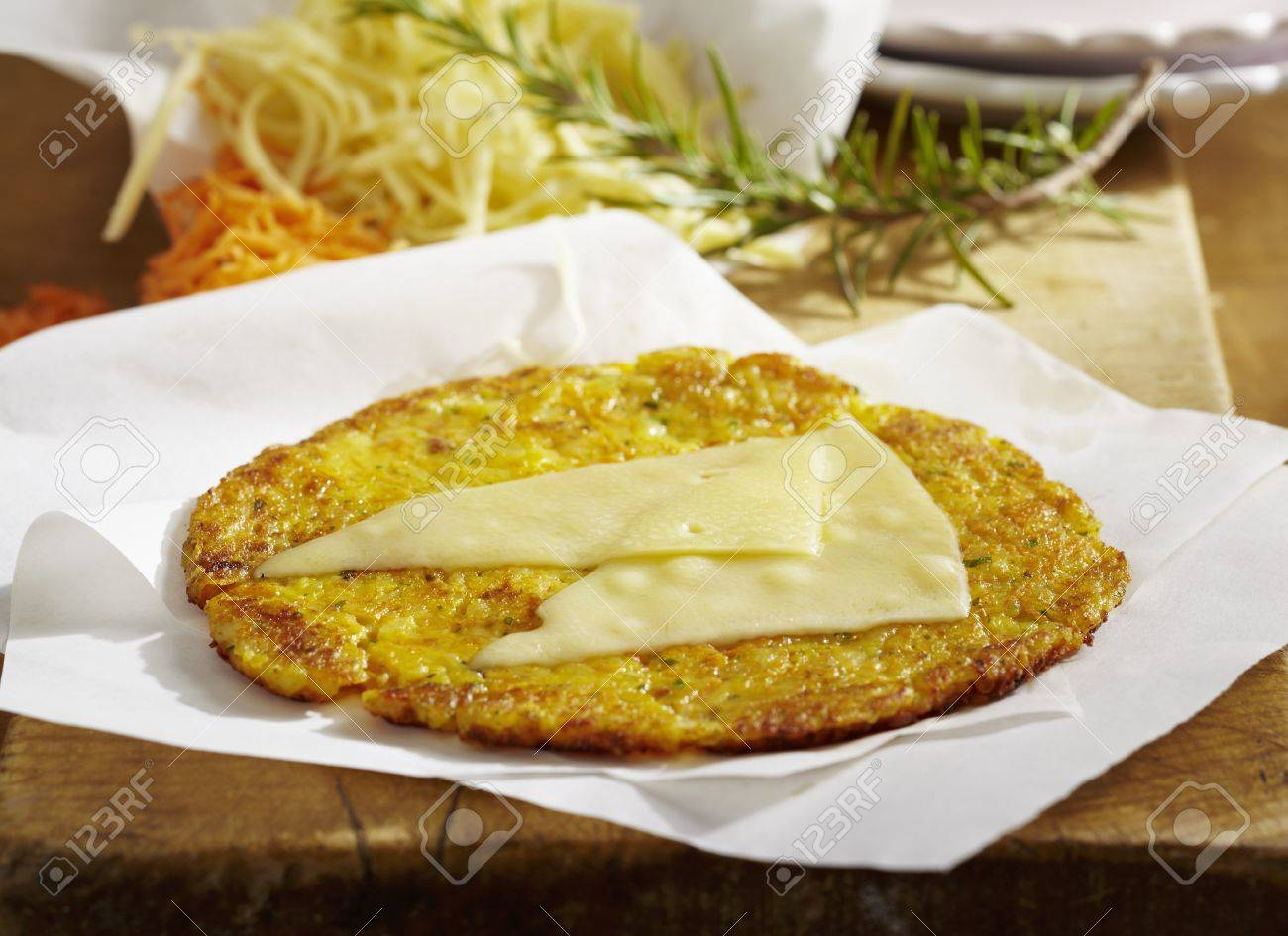 A Potato Fritter Topped With Appenzeller Cheese
