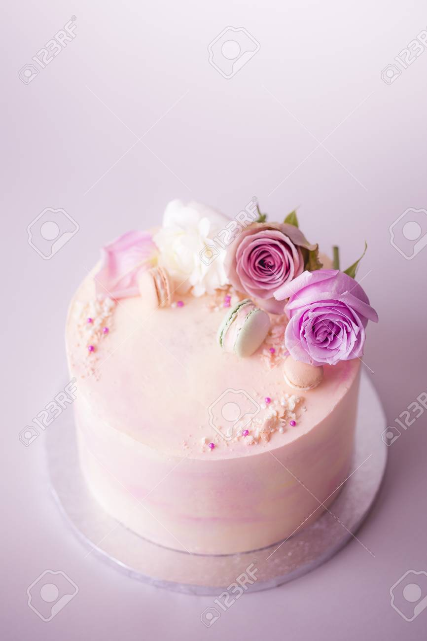 Pink Marbled Celebration Cake Decorated With Flowers Macarons
