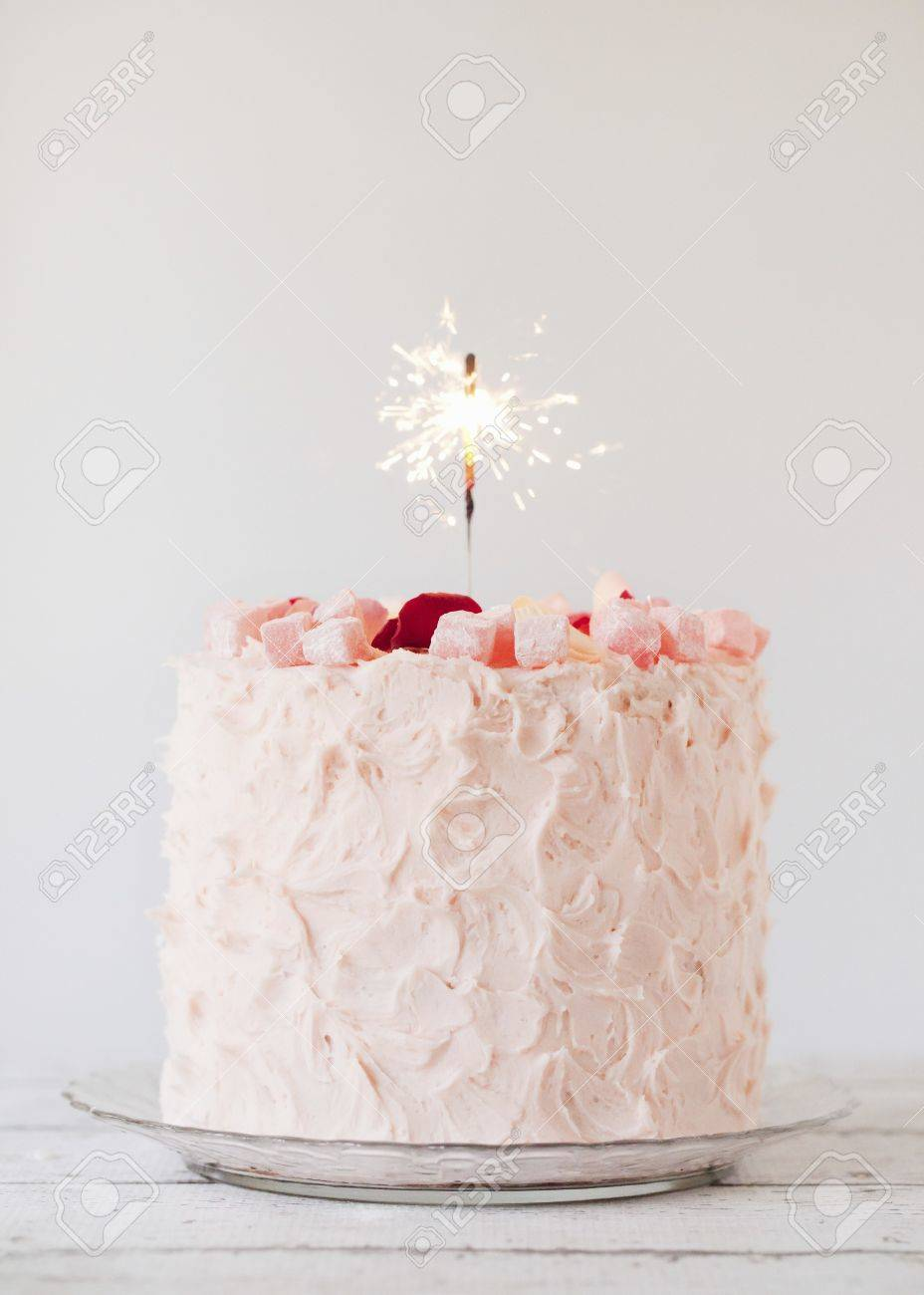 Surprising Turkish Delight Layer Cake With A Sparkler Candle Stock Photo Funny Birthday Cards Online Alyptdamsfinfo