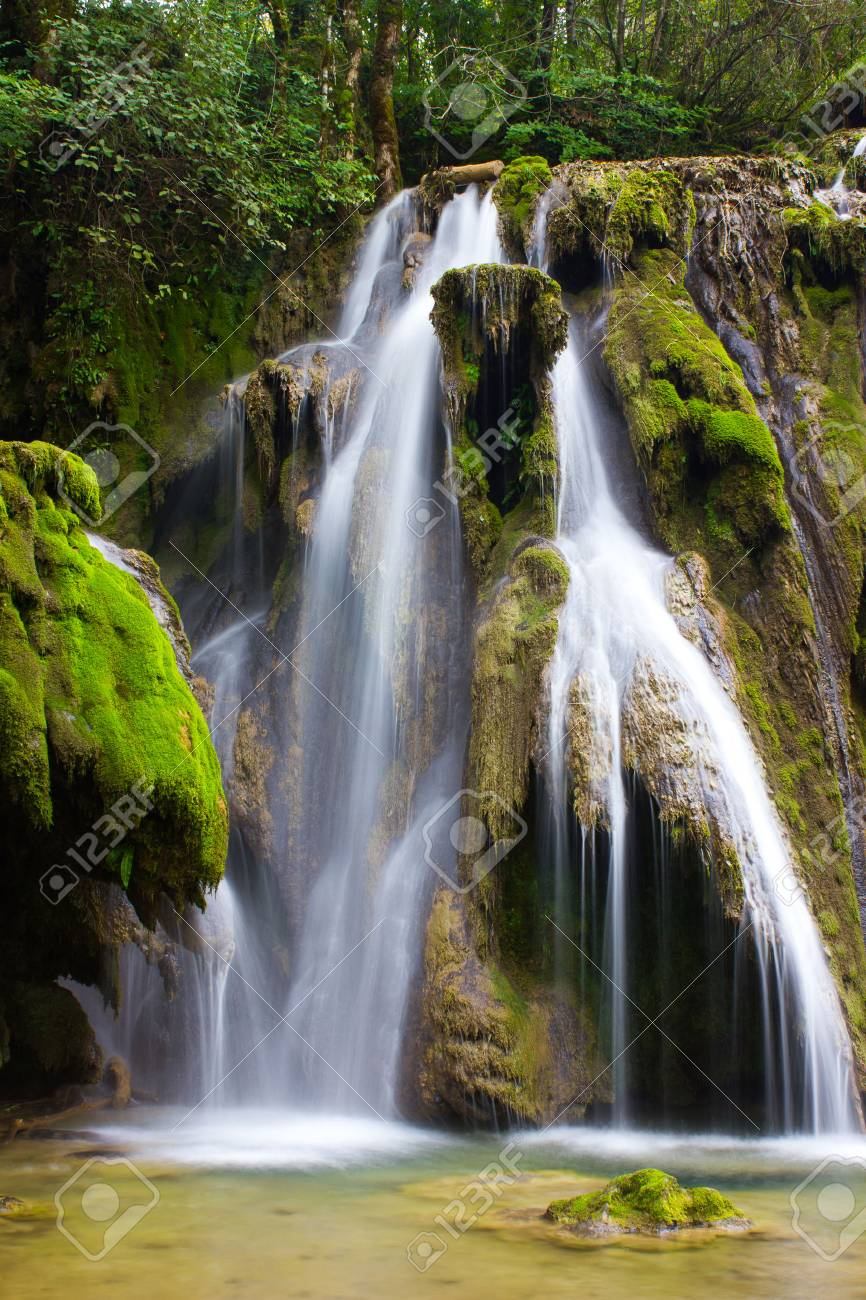 Cascade in picturesque setting Stock Photo - 22838799