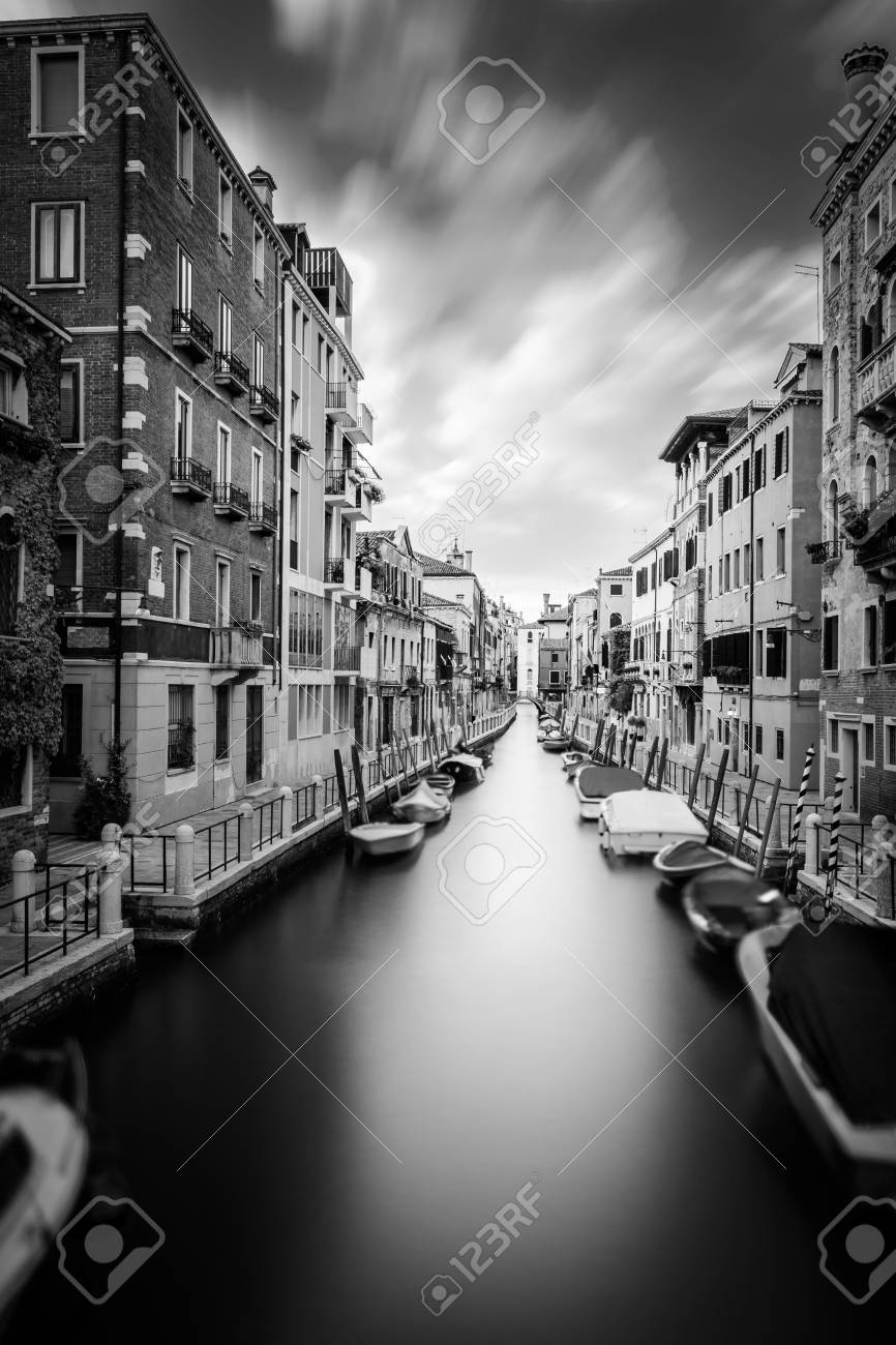 Stock photo water canal in beautiful town venice italy very long exposure black and white photography
