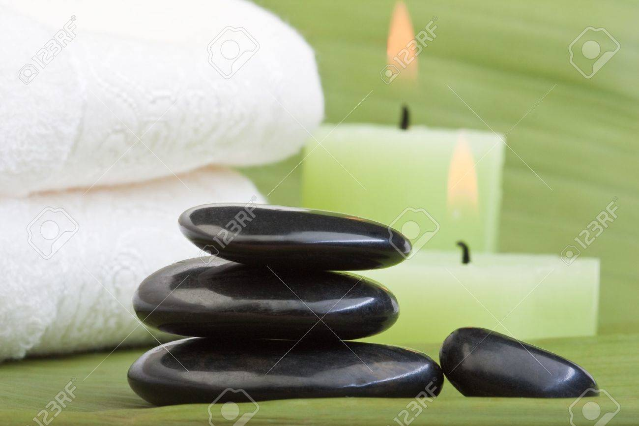 hotstones for thermotherapy with green background (1) Stock Photo - 6866544