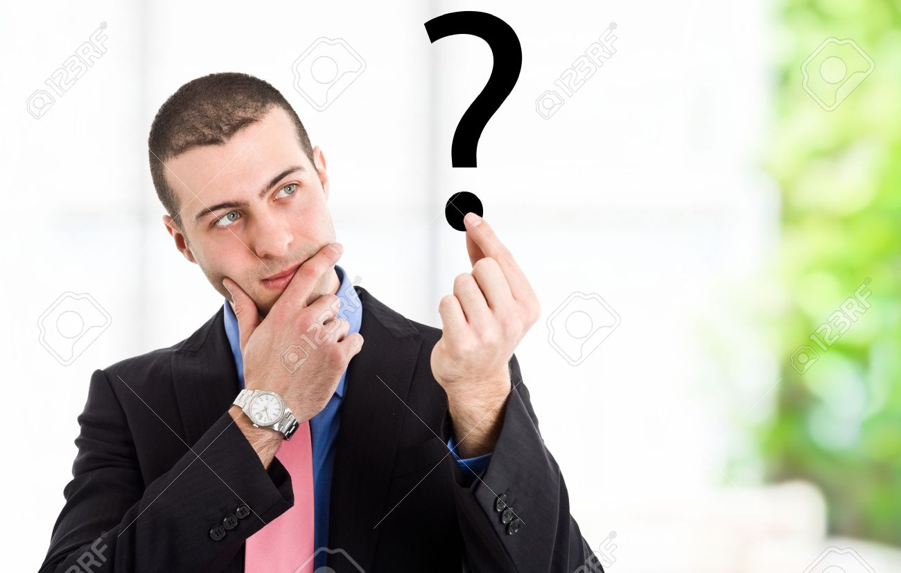 Portrait of a thoughtful man looking to a question mark Stock Photo - 13945127