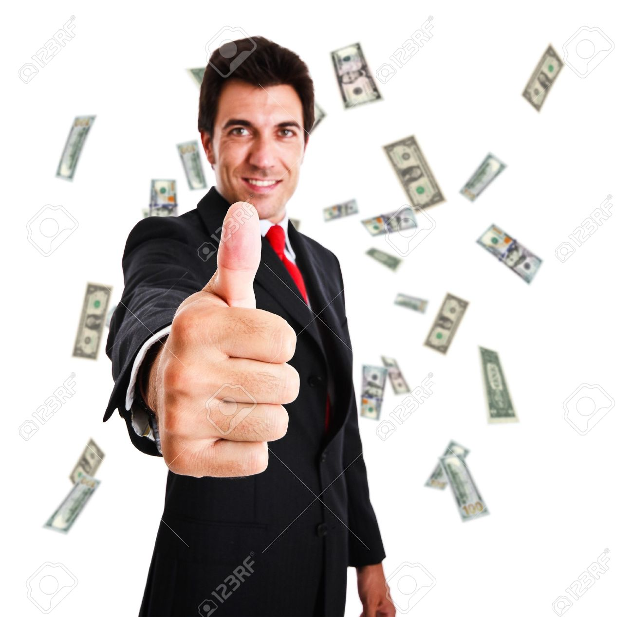 Happy man giving thums up in a rain of money Stock Photo - 13979153