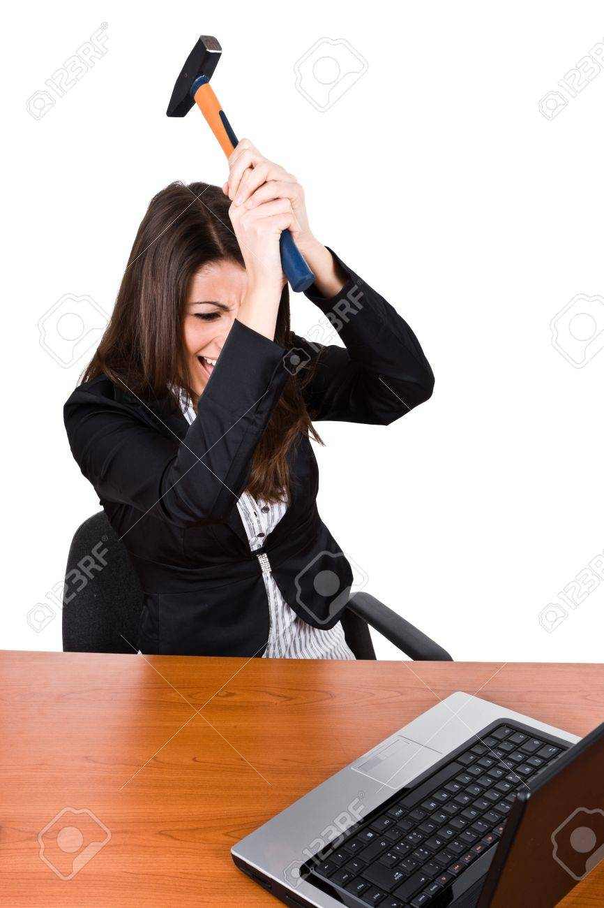 Angry woman smashing her laptop Stock Photo - 14079153