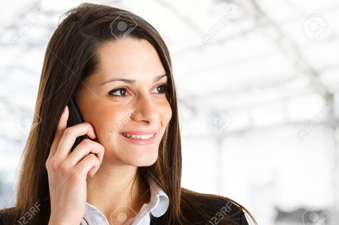 Smiling woman talking on the phone Stock Photo - 14169083