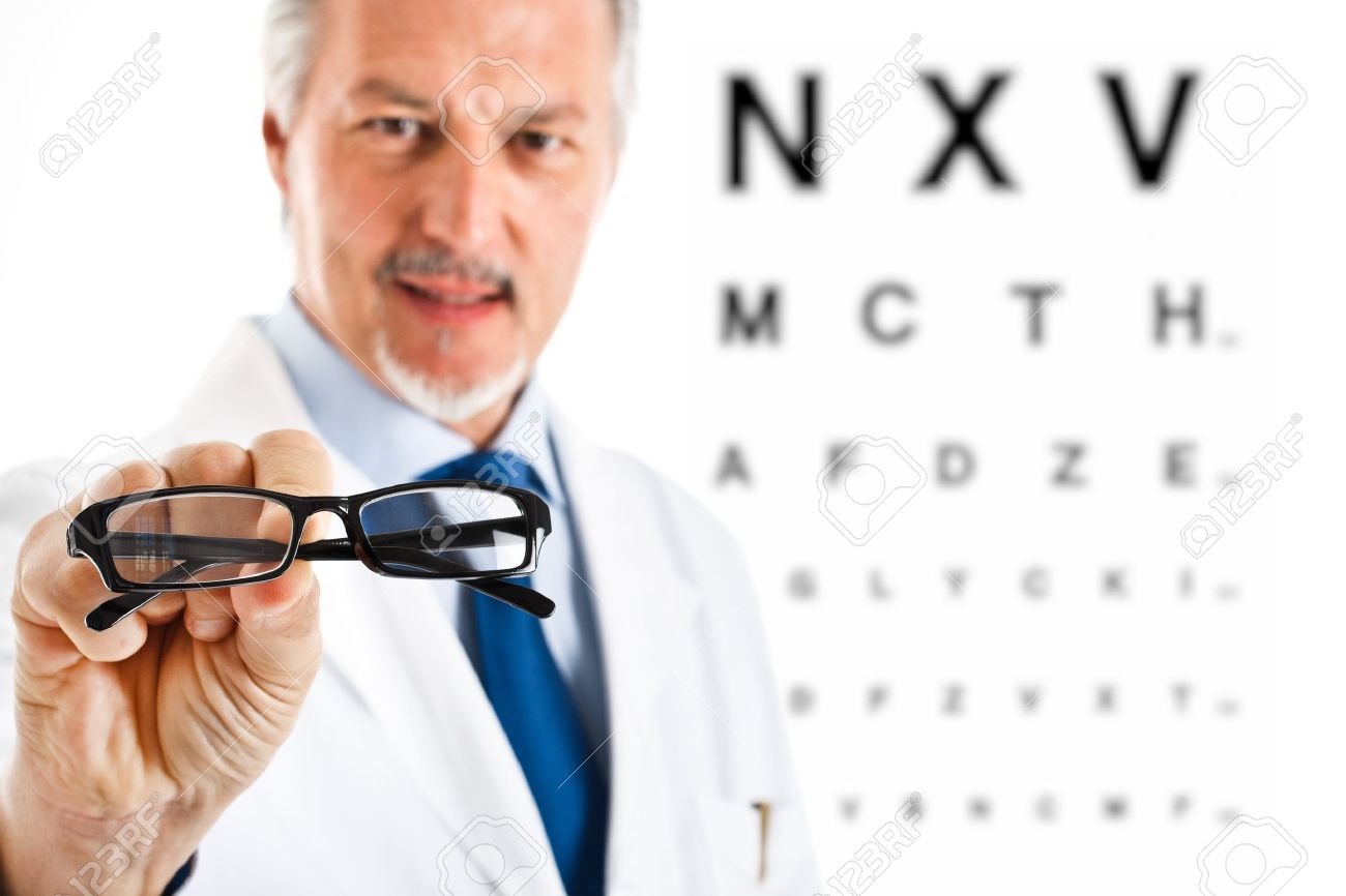 Oculist giving you a pair of glasses Stock Photo - 14329951