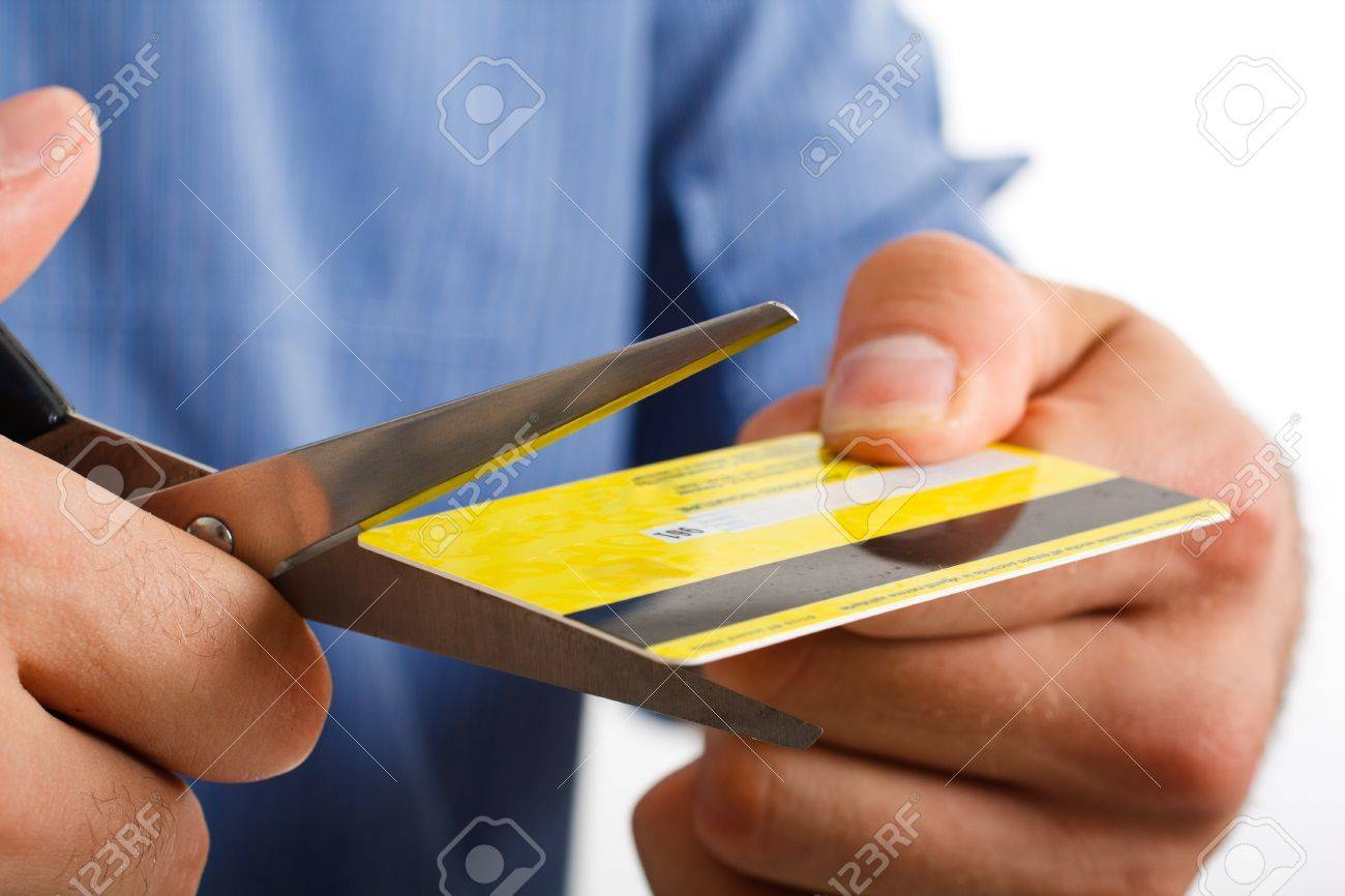 Man cutting up a credit card Stock Photo - 15216769