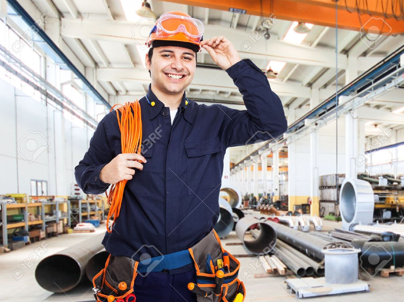 portrait of an happy worker in a factory stock photo picture and