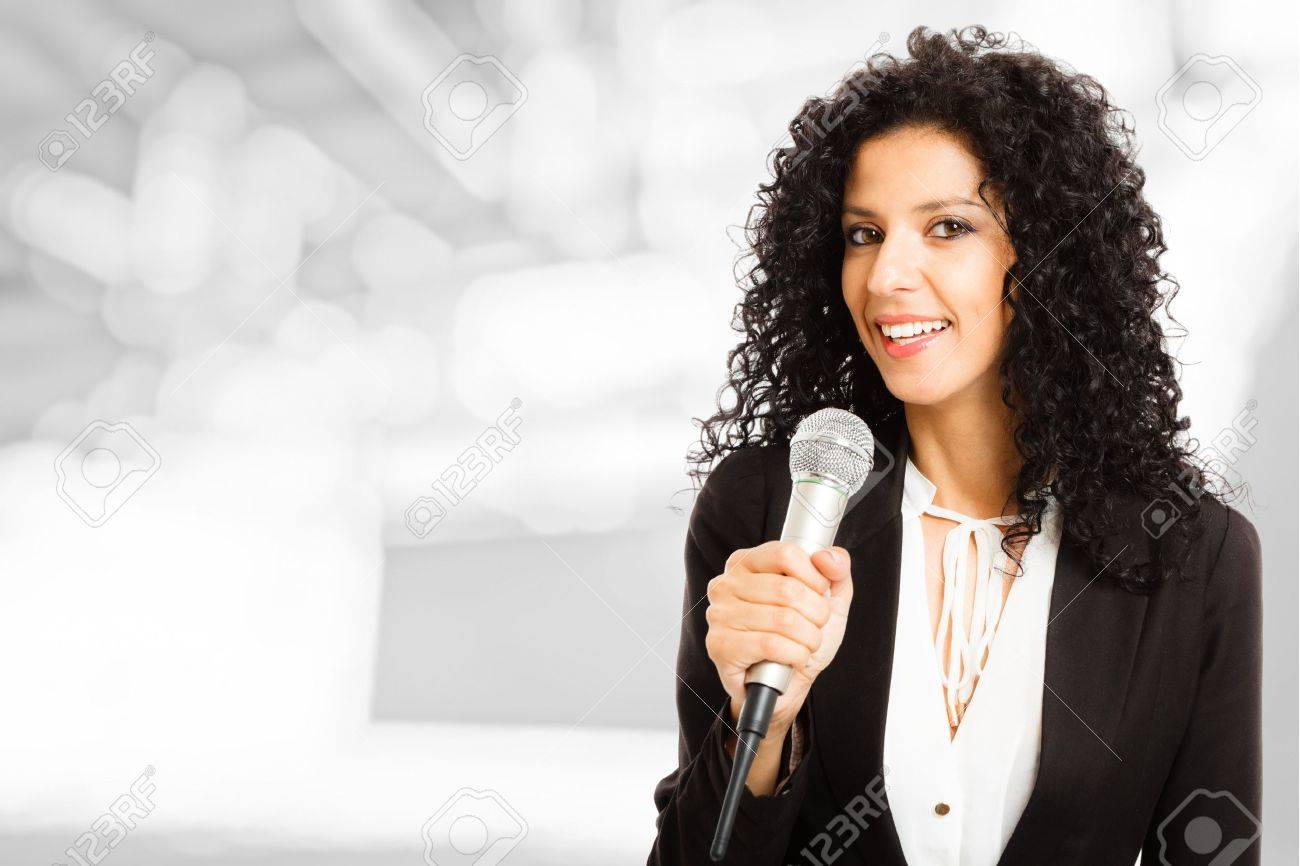Portrait of a beautiful woman speaking in a microphone Stock Photo - 15668124