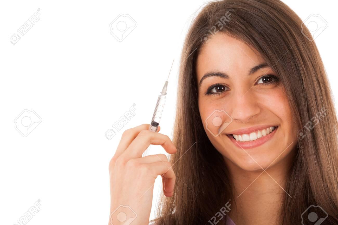 Portrait of a nurse holding a syringe  Isolated on white Stock Photo - 16732685