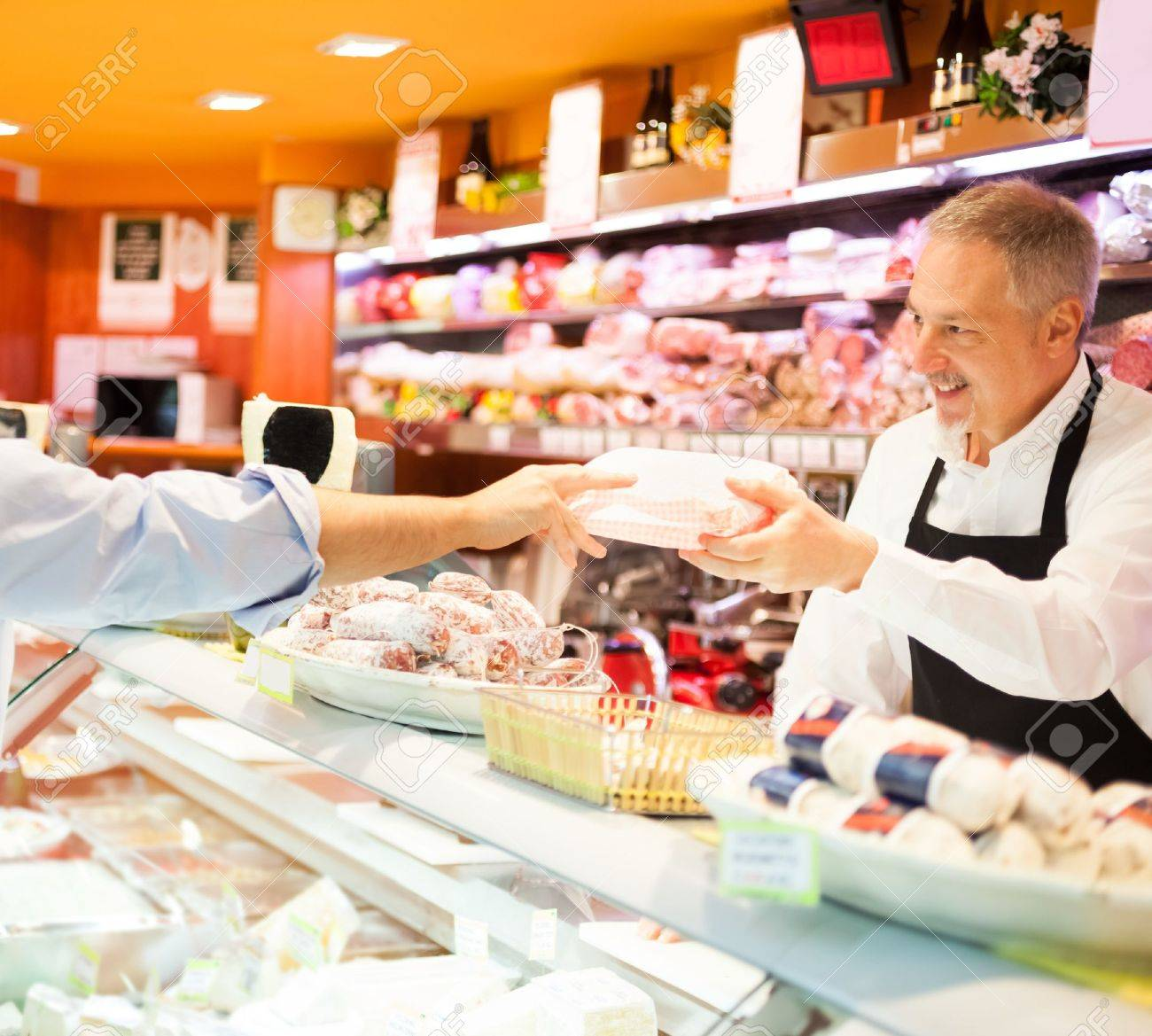 shopkeeper serving a customer in a grocery store stock photo shopkeeper serving a customer in a grocery store stock photo 16732854