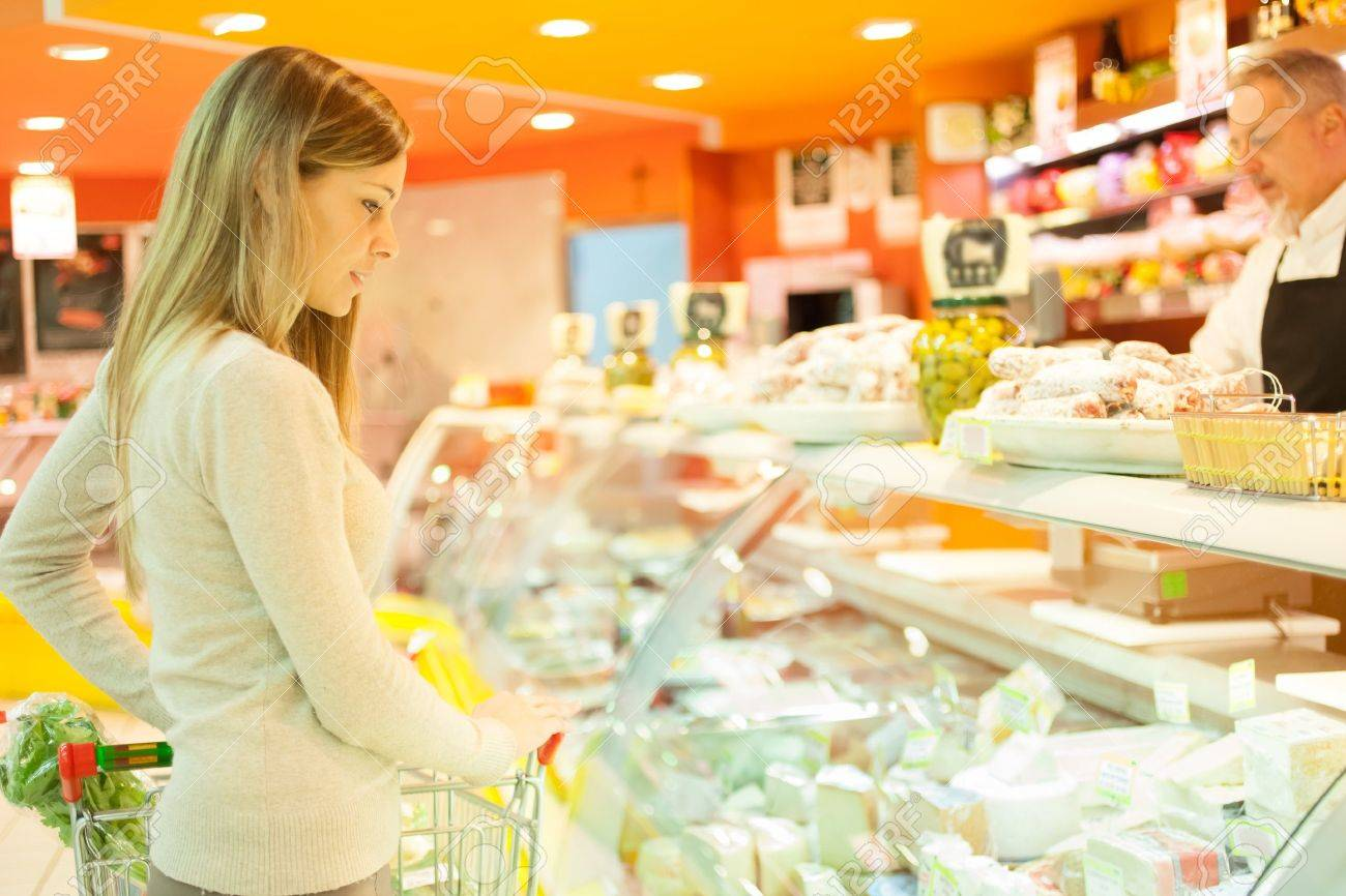 Woman shopping at the supermarket Stock Photo - 16732850