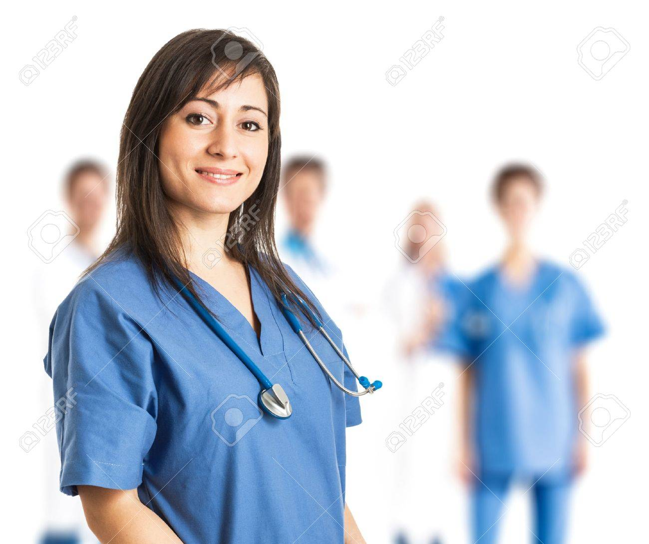 Portrait of a smiling young nurse in front of her team Stock Photo - 17184452